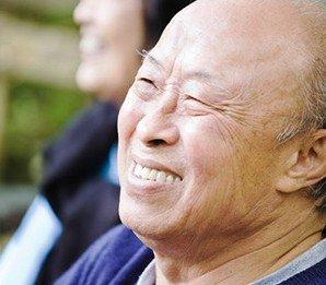 Older Asian gentleman wearing implant dentures in Wasilla, AK.
